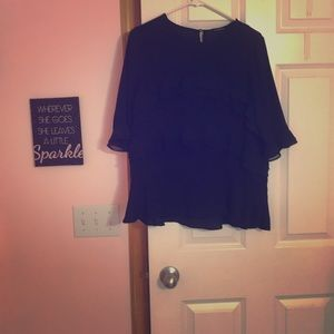 Black top with ruffled tiers